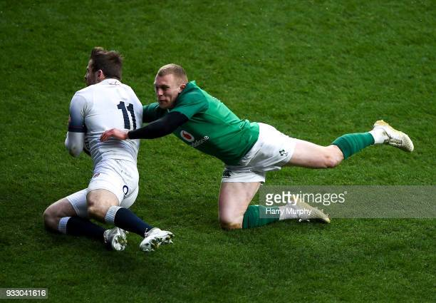 London United Kingdom 17 March 2018 Elliot Daly of England scores his side's first try despite the challenge of Keith Earls of Ireland during the...