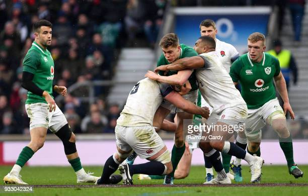 London United Kingdom 17 March 2018 Garry Ringrose of Ireland is tackled by George Kruis left and Kyle Sinckler of England during the NatWest Six...