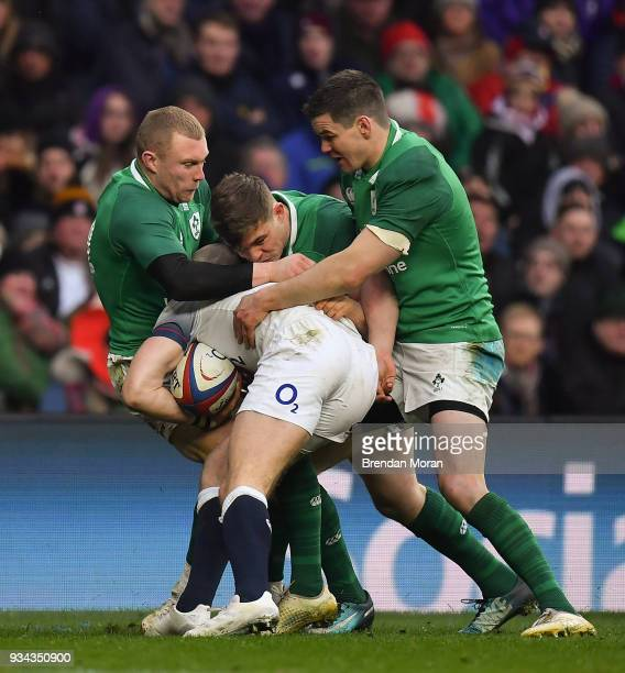 London United Kingdom 17 March 2018 Ireland players Keith Earls Garry Ringrose and Jonathan Sexton tackle Mike Brown of England during the NatWest...