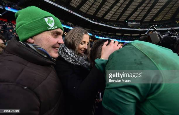 London United Kingdom 17 March 2018 Jacob Stockdale of Ireland is congratulated by his girlfriend Jessica Gardiner and father Rev Graham Stockdale...