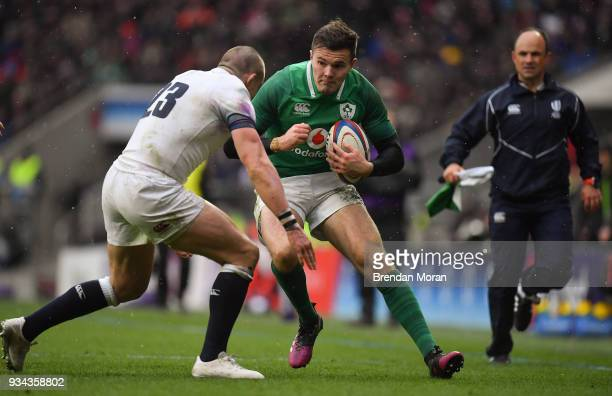 London United Kingdom 17 March 2018 Jacob Stockdale of Ireland is tackled by Mike Brown of England during the NatWest Six Nations Rugby Championship...