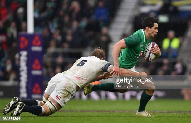 London United Kingdom 17 March 2018 Joey Carbery of Ireland is tackled by Chris Robshaw of England during the NatWest Six Nations Rugby Championship...