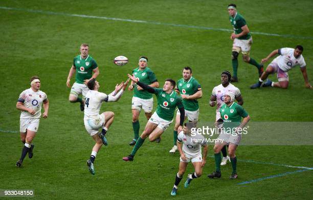 London United Kingdom 17 March 2018 Jonny May of England competes for the ball with Jacob Stockdale of Ireland during the NatWest Six Nations Rugby...