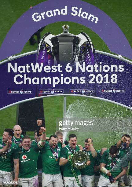 London United Kingdom 17 March 2018 The Ireland team celebrate with the Six Nations and Triple Crown trophies after the NatWest Six Nations Rugby...