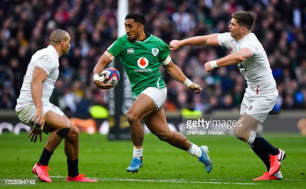 London , United Kingdom - 23 February 2020; Bundee Aki of Ireland breaks away from Jonathan Joseph and Owen Farrell of England during the Guinness...