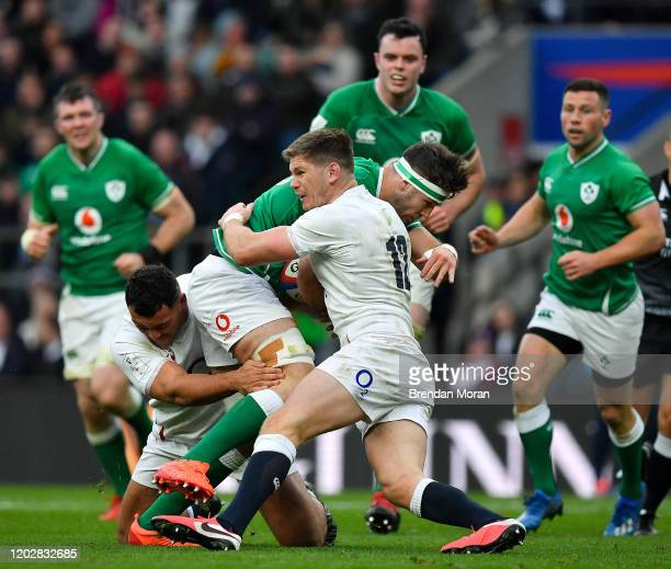 London United Kingdom 23 February 2020 Caelan Doris of Ireland is tackled by Ellis Genge and Owen Farrell of England during the Guinness Six Nations...
