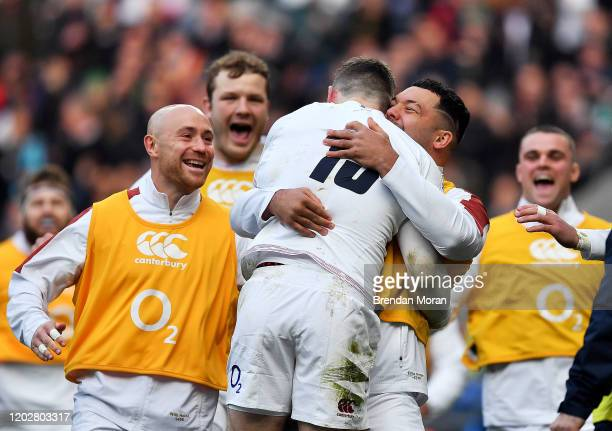 London United Kingdom 23 February 2020 Elliot Daly of England celebrates after scoring his side's second try with teammates during the Guinness Six...