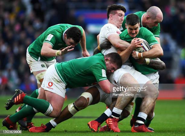 London , United Kingdom - 23 February 2020; Jonathan Sexton of Ireland, supported by team-mates James Ryan, Tadhg Furlong and Devin Toner is tackled...