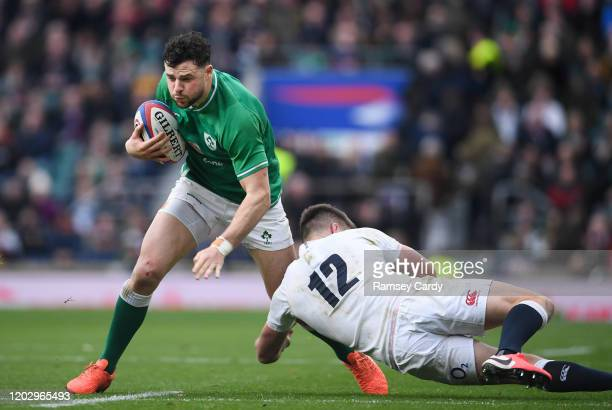 London , United Kingdom - 23 February 2020; Robbie Henshaw of Ireland in action against Owen Farrell of England during the Guinness Six Nations Rugby...