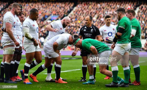 London , United Kingdom - 23 February 2020; The England and Ireland packs prepare to engage in a scrum watched by referee Jaco Peyper during the...