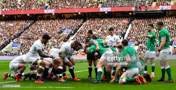 London , United Kingdom - 23 February 2020; The England and Ireland packs prepare to engage in a scrum during the Guinness Six Nations Rugby...