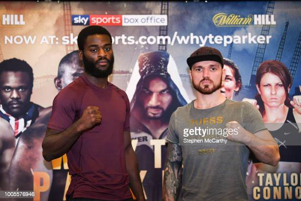 London United Kingdom 26 July 2018 Joshua Buatsi left and Andrejs Pokumeiko square off following a press conference at Canary Riverside Plaza Hotel...