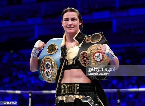 London United Kingdom 28 July 2018 Katie Taylor celebrates with both championship belts following her WBA IBF World Lightweight Championship bout...