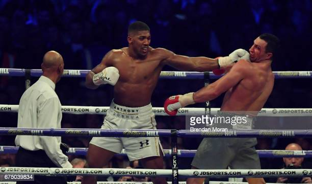 London United Kingdom 29 April 2017 Anthony Joshua centre exchanges punches with Wladimir Klitschko during their Heavyweight Championship contest for...