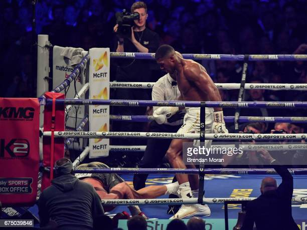 London United Kingdom 29 April 2017 Anthony Joshua knocks Wladimir Klitschko down for the first time during their Heavyweight Championship contest...