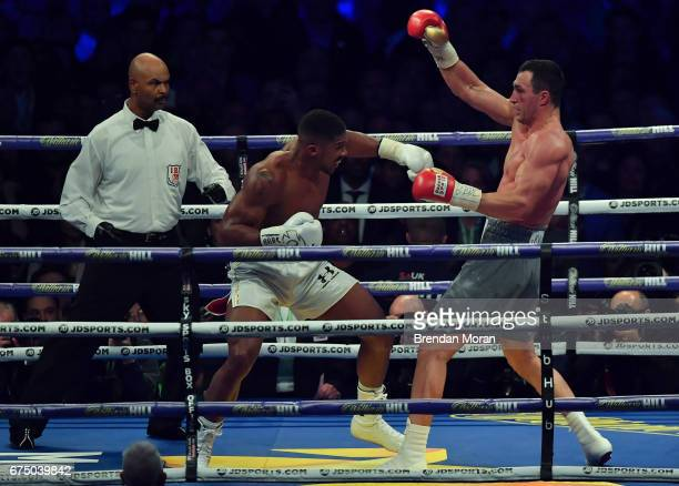 London United Kingdom 29 April 2017 Anthony Joshua left exchanges punches with Wladimir Klitschko during their Heavyweight Championship contest for...