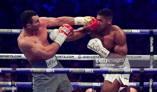 London United Kingdom 29 April 2017 Anthony Joshua right exchanges punches with Wladimir Klitschko during their Heavyweight Championship contest for...