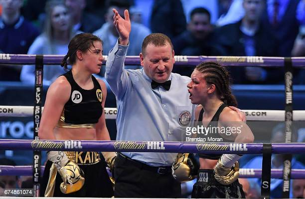 London United Kingdom 29 April 2017 Referee Howard Foster stops the fight between Katie Taylor and Nina Meinke during their WBA InterContinental...