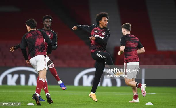 London United Kingdom 29 October 2020 Arsenal players including Willian 2nd from right warmup prior to the UEFA Europa League Group B match between...