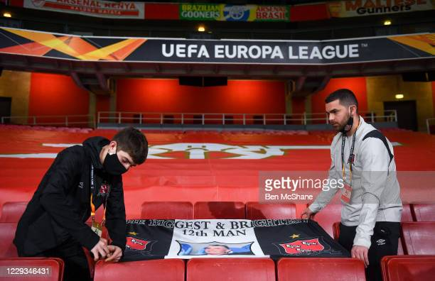 London United Kingdom 29 October 2020 Darragh Walsh left and team videographer Shane Taaffe hang out a banner in commemoration to the late Dundalk...