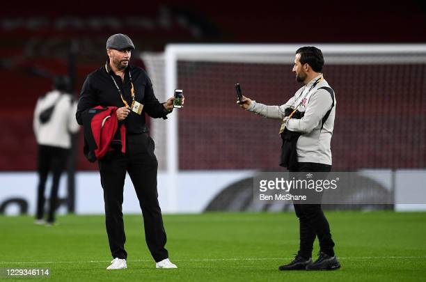 London United Kingdom 29 October 2020 Dundalk interim head coach Filippo Giovagnoli left and assistant coach Giuseppe Rossi on their mobile phones as...