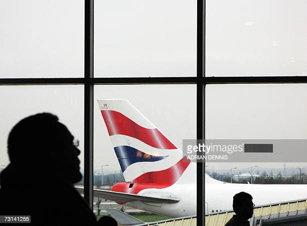 A British Airways plane is pictured outside Terminal 4 at London's Heathrow airport 29 January 2007 British Airways held lastditch talks with unions...