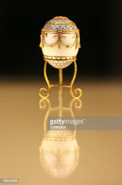 London, UNITED KINGDOM: A Faberge jewelled egg owned by King George 1 of Greece is presented at Christie's auction house in central London, 19...