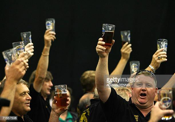 London, United Kingdom: A group of drinkers representing Skinners Brewery sing a toast during the opening day of The Great British Beer Festival in...