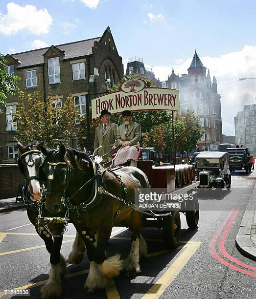 London, United Kingdom: A horse-drawn dray from Hook Norton Brewery is followed by vintage vehicles during a welcome parade of British brewers...