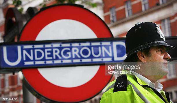 A Metropolitan police officer stands at the entrance to the Knightsbridge Underground Station in London 28 July 2005 Police have been on high alert...