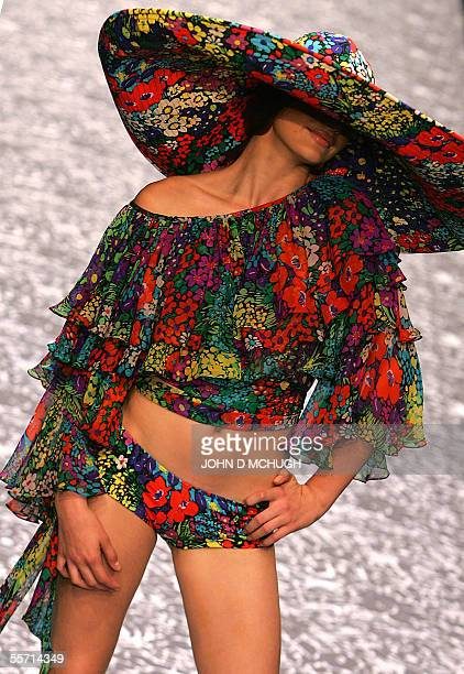 A model shows clothes by British designer Jenny Packham at the Natural History Museum in London 18 September on the first day of London Fashion Week...