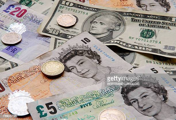 A picture taken 17 April 2007 in London shows several US dollar and UK sterling notes and coins Sterling climbed above 200 US dollars for the first...