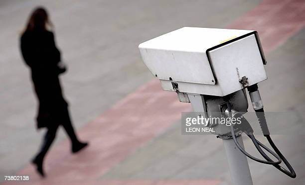 A police CCTV camera observes a woman walking in the Embankment area of central London 04 April 2007 A system of 'talking' CCTV cameras which let...