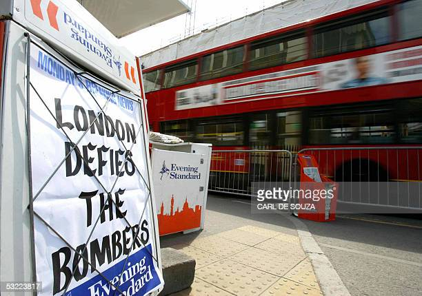 A red double decker bus drives past a newspaper advertisement at Kings Cross train station in London 11 July 2005 Prime Minister Tony Blair said...