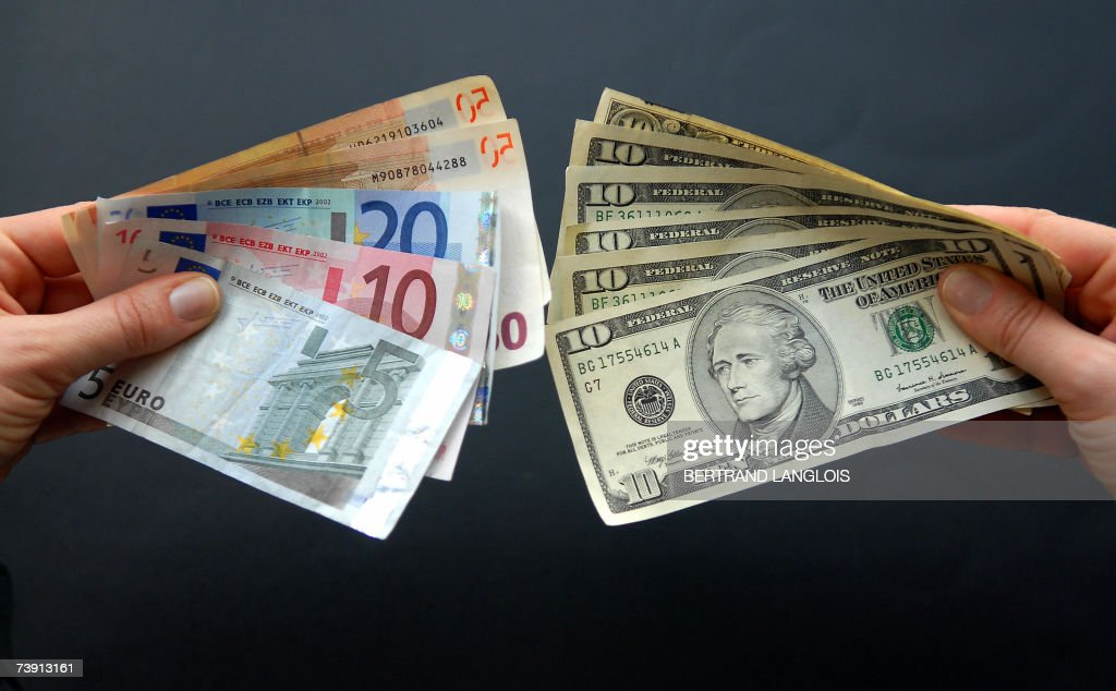 A Woman Holds Several Euro And Us Dollar News Photo