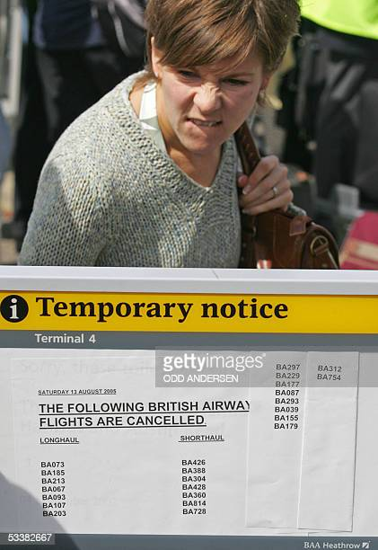 A woman reads the list of cancelled British airways at London Heatrhows terminal 4 13 August 2005 85 % of British Airways flights from the British...