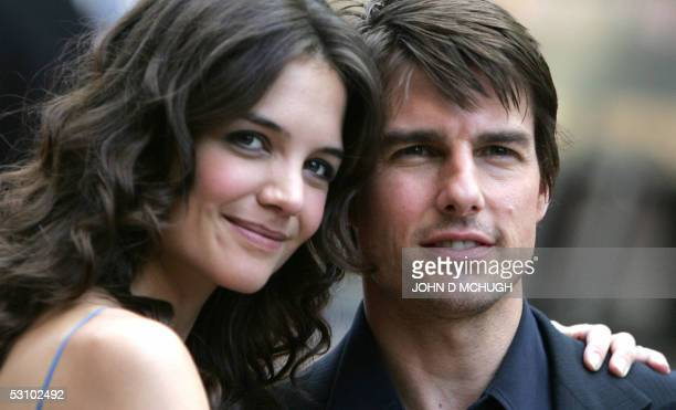 Actor Tom Cruise arrives with fiancee actress Katie Holmes in London's Leicester Square for the UK premiere of his new movie War of the Worlds 19...