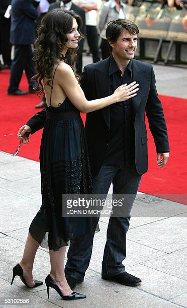 London, UNITED KINGDOM: Actor Tom Cruise arrives withKatie Holmes in London's Leicester Square for the UK premiere of his new movie War of the...