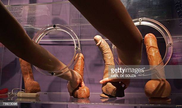 An employee demonstrates a sex toy at Amora Sex Acadamy a new attraction about sexual relationships London April 19 2007 Amora features a number of...