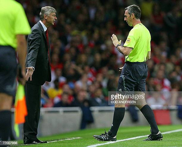 Arsenal manager Arsene Wenger gets a warning from referee Stefano Farina during a group G Champions league match against FC Porto at Emirates Stadium...