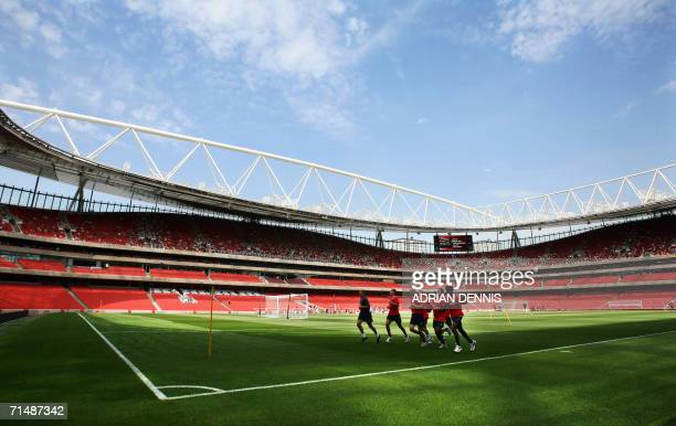 Arsenal players warmup at the new Emirates Stadium in London 20 July 2006 The stadium on a 17 acre site has a capacity of 60000 spectators and cost...