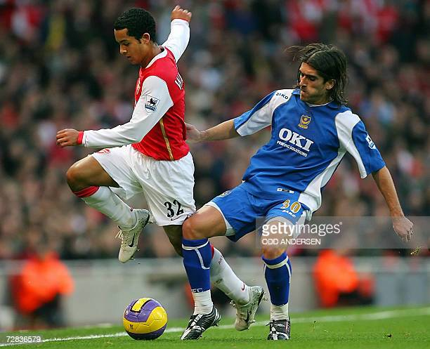 Arsenal striker Theo Walcott vies for the ball with Pedro Mendes of Portsmouth during their Premeirship game at Emirates Stadium in north London 16...