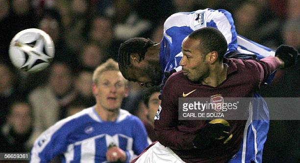 Arsenal's Captain Thierry Henry heads the ball past Wigan's Pascal Chimbonda during their Carling Cup match at Arsenal's grounds 24 January 2006 AFP...