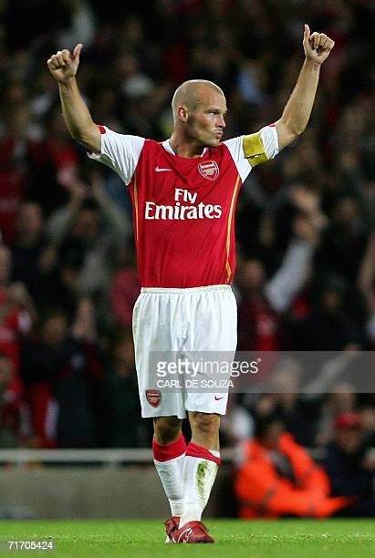 Arsenal's Freddie Ljungberg celebrates after scoring to equalise 11 during their Champions League qualifying match against Dinamo Zagreb in London 23...