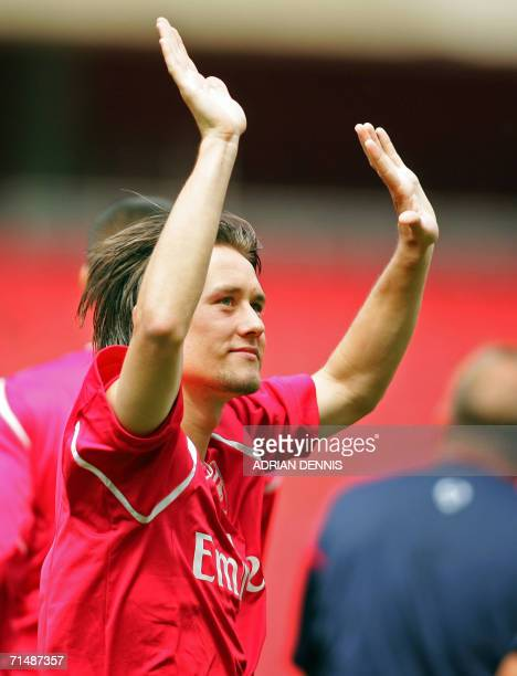 Arsenal's new signup Tomas Rosicky of the Czech Republic acknowledges the crowd as Arsenal players warmup at the new Emirates Stadium in London 20...