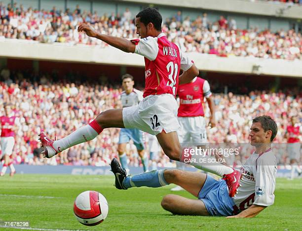 London, UNITED KINGDOM: Arsenal's Theo Walcott jumps over the ball during a Premiership football match against Aston Villa at the newly built Arsenal...