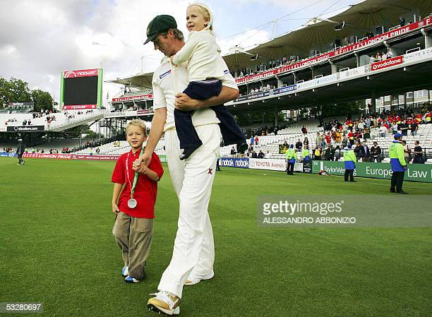 Australian bowler Glenn McGrath takes his children Holly and James to the Pavilion after Australia beat England in the first Test match at Lords...