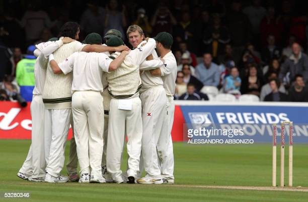 Australian players celebrate winning the first Ashes Test at Lords cricket ground in London 24 July 2005 after Glenn McGrath took the final English...