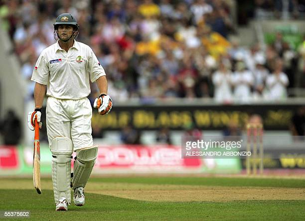 Australia's Adam Gilchrist leaves the field after losing his wicket to England's Matthew Hoggard on the fourth day of the fifth and final Ashes Test...