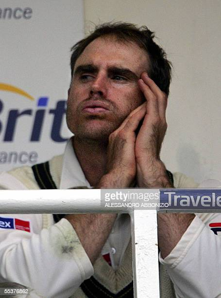 Australia's Matthew Hayden gestures as he keeps an eye on the weather from the dressing room as play is suspended due to bad light on the fourth day...